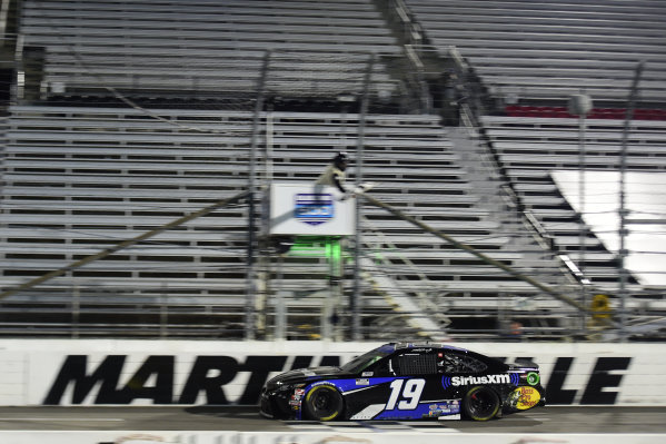Martin Truex Jr., Joe Gibbs Racing Toyota SiriusXM, crosses the finish line to win, Copyright: Jared C. Tilton/Getty Images.