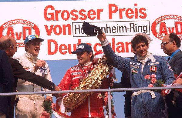 1977 German Grand Prix.Hockenheim, Germany.29-31 July 1977.Niki Lauda (Ferrari) 1st position, Jody Scheckter (Wolf Ford) 2nd position and Hans-Joachim Stuck (Brabham Alfa Romeo) 3rd position on the podium.Ref-77 GER 01.World Copyright - LAT Photographic