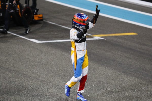 Fernando Alonso, McLaren, waves to the fans after completing his final race in F1