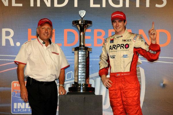8-9 October, 2009, Homestead, Florida USAJ R. Hildebrand and Firestone's Joe Barbieri pose with the Champion's trophy after J R. won the Firestone Indy Lights Championship.©2009, Paul Webb, USALAT Photographic