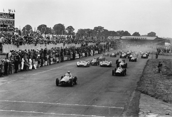 Silverstone, Great Britain. 17 July 1954. Jose Froilan Gonzalez, Ferrari 625/555, 1st position, leads Stirling Moss, Maserati 250F, retired, Mike Hawthorn, Ferrari 625/555, 2nd position, Juan Manuel Fangio, Mercedes-Benz W196, 4th position, Jean Behra, Gordini 16, retired, and Karl Kling, Mercedes-Benz W196, 7th position at the start, action. World Copyright: LAT Photographic
