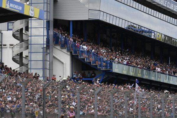 Fans in grandstands, atmosphere
