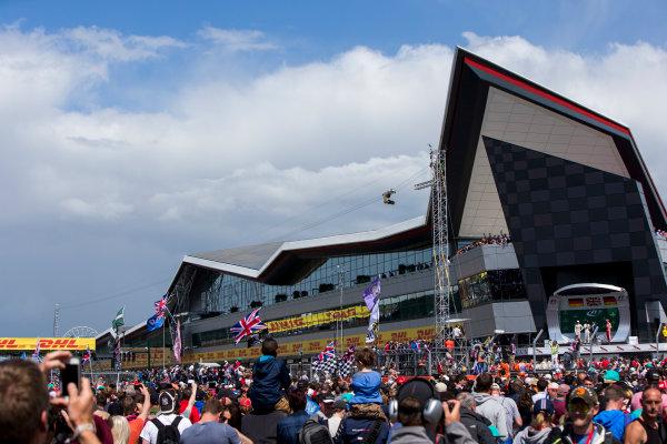 Silverstone, Northamptonshire, England. Sunday 5 July 2015. Lewis Hamilton, Mercedes AMG, 1st Position, Nico Rosberg, Mercedes AMG, 2nd Position, and Sebastian Vettel, Ferrari, 3rd Position, on the podium. World Copyright: Zak Mauger/LAT Photographic. ref: Digital Image _L0U6604