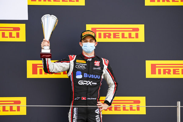 Louis Deletraz (CHE, CHAROUZ RACING SYSTEM) celebrates on the podium with the trophy