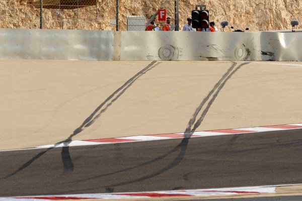 Tyre marks and an imprint on the barrier are left by Lewis Hamilton's McLaren MP4-23 Mercedes after a crash in practice.