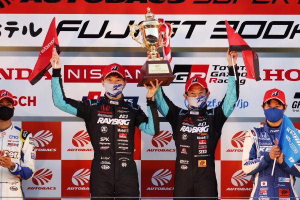 2020 GT500 Drivers' Champions Naoki Yamamoto & Tadasuke Makino ( #100 RAYBRIG Honda NSX-GT ) celebrate on the podium