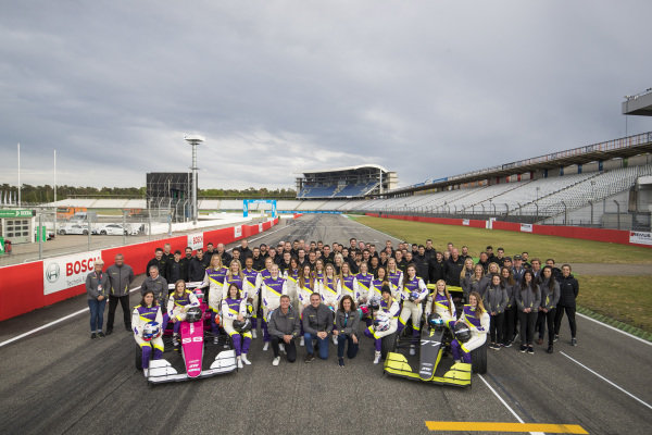 The drivers and teams pose for a pre season photo