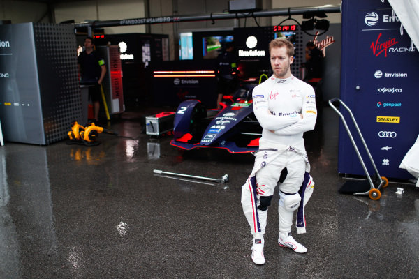 Sam Bird (GBR), Envision Virgin Racing stands in front of his Audi e-tron FE05 in the pit lane