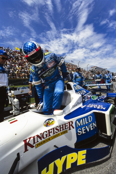 Jean Alesi climbs from his Benetton B196 Renault on the grid.