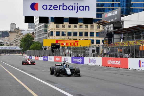 Jack Aitken (GBR, HWA Racelab), leads Oscar Piastri (AUS, Prema Racing)