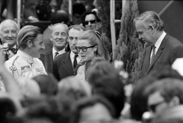 Graham Hill, 1st position, on the podium with Princess Grace and Prince Rainier.
