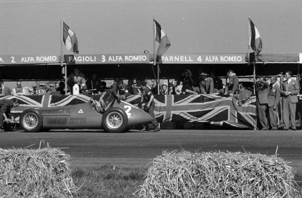 Mechanics work on the car of Giuseppe Farina, Alfa Romeo 158, in the pit lane.