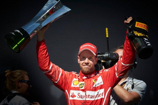 Interlagos, Sao Paulo, Brazil. Sunday 12 November 2017. Sebastian Vettel, Ferrari, 1st Position, with his trophy and Champagne bottle. World Copyright: Steve Etherington/LAT Images  ref: Digital Image SNE17546