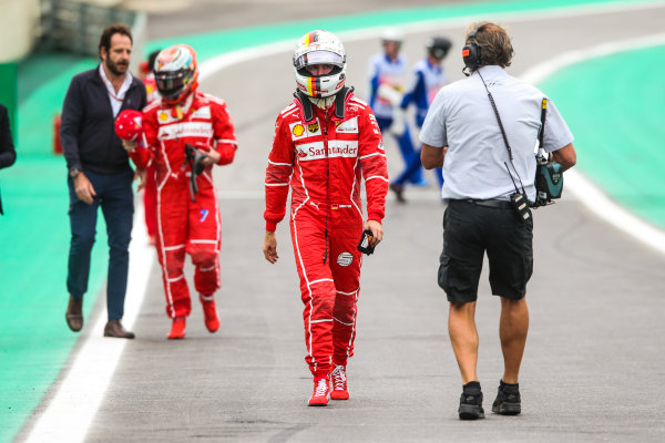 Interlagos, Sao Paulo, Brazil. Saturday 11 November 2017. Sebastian Vettel, Ferrari, and Kimi Raikkonen, Ferrari, walk to Parc Ferme after mistakenly parking on the grid after Qualifying. World Copyright: Charles Coates/LAT Images  ref: Digital Image AN7T3912