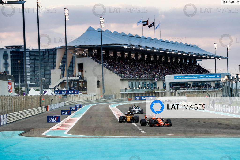 Yas Marina Circuit, Abu Dhabi, United Arab Emirates. Sunday 26 November 2017. Fernando Alonso, McLaren MCL32 Honda, leads Carlos Sainz Jr, Renault R.S.17, and Lance Stroll, Williams FW40 Mercedes. World Copyright: Zak Mauger/LAT Images  ref: Digital Image _56I2848