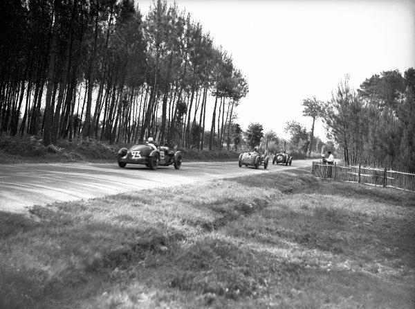1934 Le Mans 24 hours. Le Mans, France. 16-17 June 1934. Mortimer Morris-Goodall & John Elwes (#23 Aston Martin Ulster), retired, Felix Quinault & Danielault (Tracta), 19th, Adrien & Gilbert Alin (B.N.C.), 21st, World Copyright: LAT Photographic Ref: Autocar Glass Plate C4007