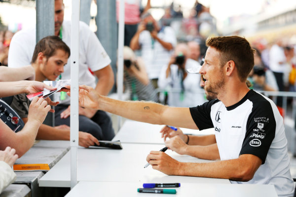 Hungaroring, Budapest, Hungary. Thursday 23 July 2015. Jenson Button, McLaren, signs autographs for fans.  World Copyright: Charles Coates/LAT Photographic ref: Digital Image _J5R0974