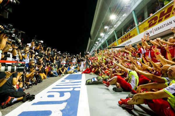 Marina Bay Circuit, Singapore. Sunday 20 September 2015. Sebastian Vettel, Ferrari, Kimi Raikkonen, Ferrari, and the Ferrari team celebrate victory and a double podium. World Copyright: Alastair Staley/LAT Photographic. ref: Digital Image _R6T7574
