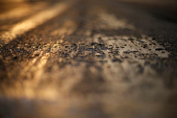 Hungaroring, Budapest, Hungary. Friday 24 July 2015. Track surface detail as the sun rises. World Copyright: Charles Coates/LAT Photographic ref: Digital Image _J5R4557