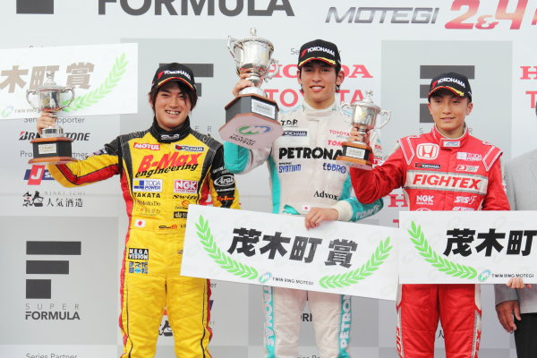 Motegi, Japan. 3rd - 4th August 2013. Rd 5. Race 1 - Winner  Yuichi Nakayama ( #36 PETRONAS TEAM TOM'S ) 2nd position Katsumasa Chiyo ( #50 B-MAX ENGINEERING ) 3rd position Tomoki Nojiri ( #2  TODA RACING ) podium, portrait.  World Copyright: Yasushi Ishihara/LAT Photographic. Ref: 2013JF3_Rd10_008