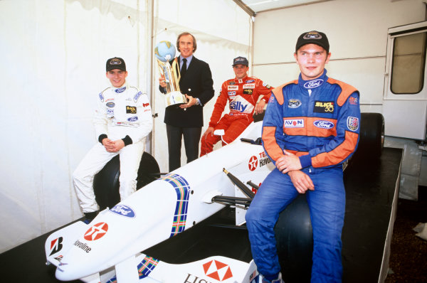 Brands Hatch, England. 19th October1997. Dan Wheldon,  Sir Jackie Stewart, Jacky Van Der Ende an xxx with the World Cup, portrait.   World Copyright: LAT Photographic. Ref:  Colour Transparency.
