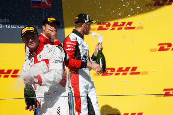 2014 GP3 Series. Round 8.   Sochi Autodrom, Sochi, Russia. Sunday Race 2 Sunday 12 October 2014. Dean Stoneman (GBR, Marussia Manor Racing) sprays the champagne on the podium. Photo: Sam Bloxham/GP3 Series Media Service. ref: Digital Image _G7C7726