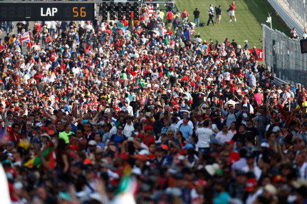 Circuit of the Americas, Austin, Texas, United States of America. Sunday 2 November 2014. The crowd invade the track after the race. World Copyright: Alastair Staley/LAT Photographic. ref: Digital Image _R6T4353