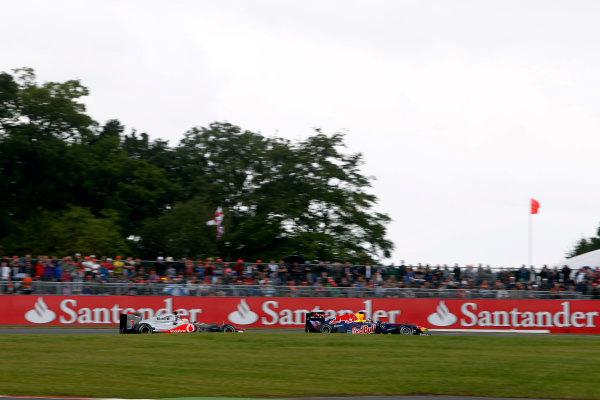 Silverstone, Northamptonshire, England9th July 2011Sebastian Vettel, Red Bull Racing RB7 Renault, leads Lewis Hamilton, McLaren MP4-26 Mercedes. Action. World Copyright:Andrew Ferraro/LAT Photographicref: Digital Image _Q0C8526