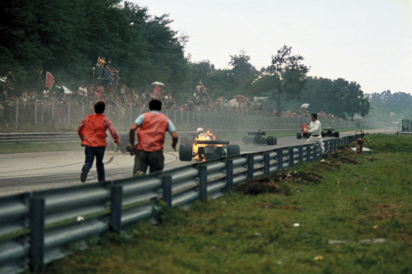 Monza, Italy.8-10 September 1972.Clay Regazzoni climbs out of his Ferrari 312B2 after it burst into flames after he came through the Roggia Chicane, action. World Copyright: LAT Photographic.Ref:  72ITA33.