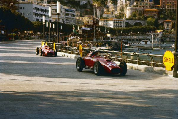 Monte Carlo, Monaco. 16-19 May 1957. Wolfgang von Trips (Lancia-Ferrari D50 801) leads Juan Manuel Fangio (Maserati 250F) in practice. Ref-57 MON 21. World Copyright - LAT Photographic