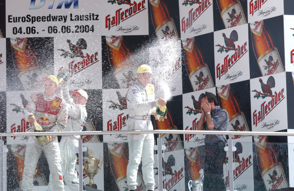 2004 DTM Championship Lausitzring. Germany. 4th - 6th June 2004. Race podium. Gary Paffet (HWA Mercedes C-Class) 1st, Mattias Ekstrom (Abt Sportsline Audi A4) 2nd and Christijan Albers (HWA Mercedes C-Class) 3rd. Paffett would later be disqualified with fuel iregulatities.World Copyright: Andre Irlmeier/LAT Photographic ref: Digital Image Only