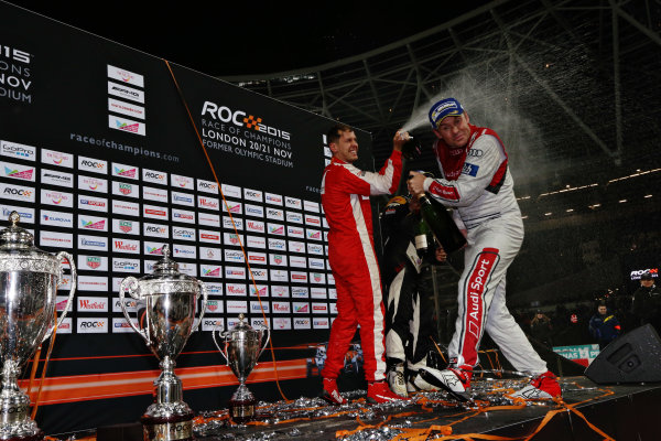 2015 Race Of Champions Olympic Stadium, London, UK Saturday 21 November 2015 Sebastian Vettel (GER) celebrates on the podium with Tom Kristensen (DMK) Copyright Free FOR EDITORIAL USE ONLY. Mandatory Credit: 'IMP'