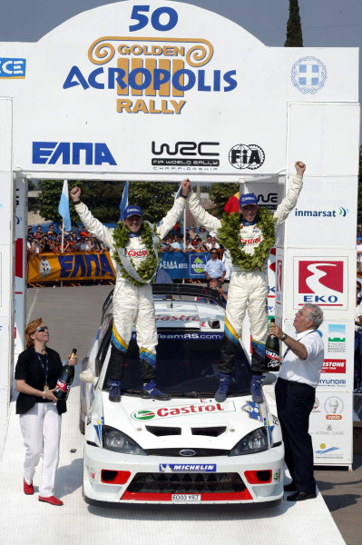 Markko Martin & co-driver Michael Park celebrate victory, Ford Focus RS WRC03, Acropolis Rally 2003.Photo: McKlein/LAT