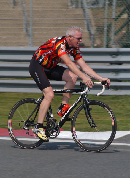 """2003 Champ Car Series 22-24 August 2003Molson Indy Montreal Circuit Gilles Villeneuve.Montreal, Quebec, Canada. Paul Tracy takes to the track on his bike for Thursday """"track walk.""""2003- Dan R. Boyd USA LAT Photography"""