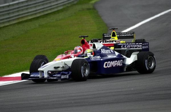 2001 Malaysian Grand Prix.Sepang, Kuala Lumpur, Malaysia. 16-18 March 2001.Ralf Schumacher (Williams FW23 BMW) and Rubens Barrichello (Ferrari F2001) battle for position.World Copyright - Photo 4/LAT Photographic.ref: 8mb Digital Image