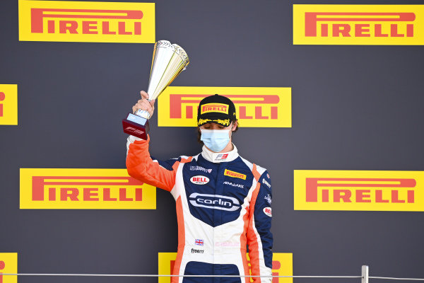 Clement Novalak (GBR, CARLIN BUZZ RACING) celebrates on the podium with the trophy