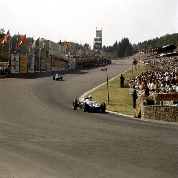 1958 Belgian Grand Prix.Spa-Francorchamps, Belgium.13-15 June 1958.Roy Salvadori (Cooper T45 Climax) leads Harry Schell (BRM P25) into Eau Rouge. They finished in 8th and 5th positions respectively.Ref-3/0054.World Copyright - LAT Photographic