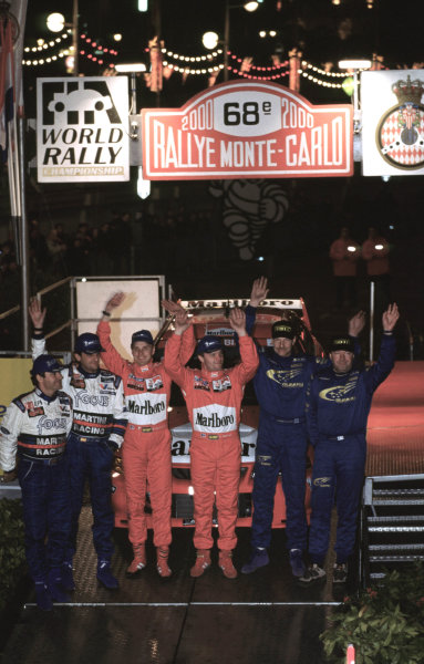 WRC Monte Carlo 2000Tommi Makinen celebrates victory with 2nd place Carlos Sainz and 3rd place Juna Kankunnen.Photo: McKlein/LATTel: +44 (0)181 251 3000Fax: +44 (0)181 251 3001Somerset House, Somerset Road, Teddington, Middlesex, United Kingdon. TW11 8RU
