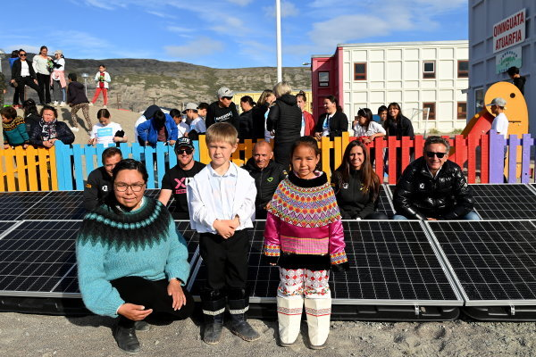 Local school children take part in the official switching on of solar panels for the Greenland Solar Project