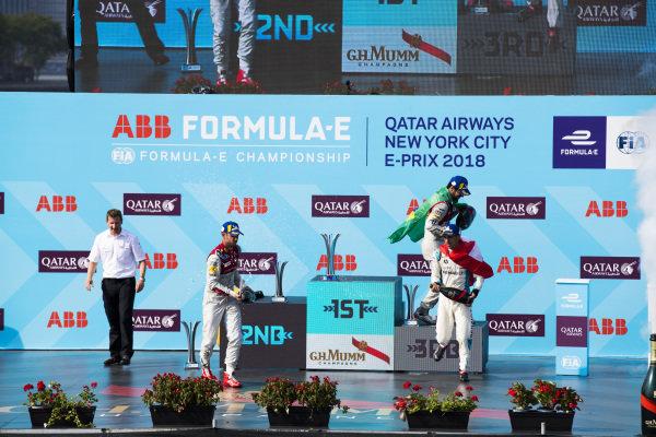 Daniel Abt (GER), Audi Sport ABT Schaeffler, Audi e-tron FE04,Lucas Di Grassi (BRA), Audi Sport ABT Schaeffler, Audi e-tron FE04, and Sébastien Buemi (SUI), Renault e.Dams, Renault Z.E 17, celebrate on the podium after the race.