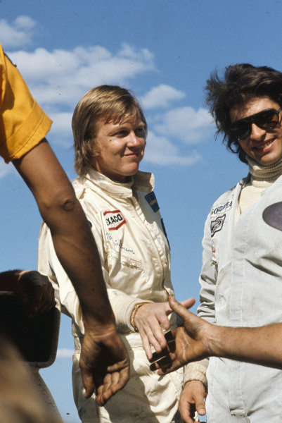 Ronnie Peterson, 2nd position, on the podium with Francois Cevert, 3rd position.