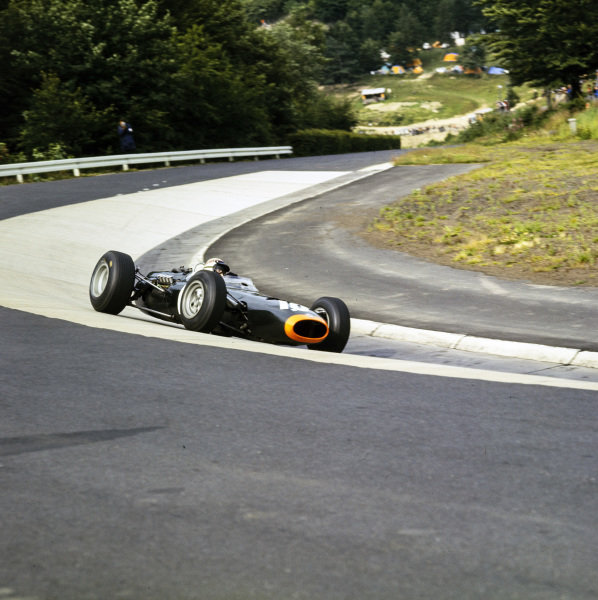 Jackie Stewart, BRM P261, rounds the Karoussel.
