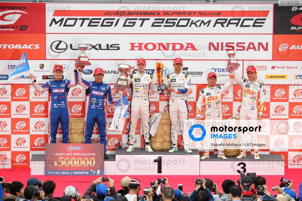 GT500 Winners Ryo Hirakawa & Nick Cassidy, Lexus Team KeePer TOM'S LC500, celebrate on the podium. They are joined by second position and 2019 Drivers' champions Kazuya Oshima & Kenta Yamashita, Lexus Team Le Mans Wako's Lexus 4CR LC500 and third position Kazuki Nakajima & Yuhi Sekiguchi, Lexus Team au TOM'S LC500
