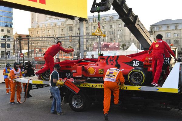 Crashed car of Charles Leclerc, Ferrari SF90 is retuned to Ferrari mechanics on the back of a low loader