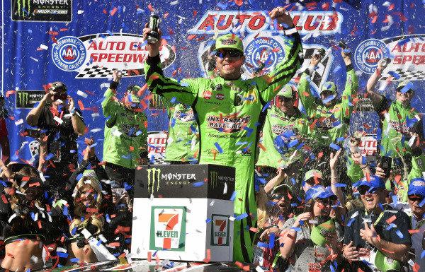 #18: Kyle Busch, Joe Gibbs Racing, Toyota Camry Interstate Batteries celebrates his win