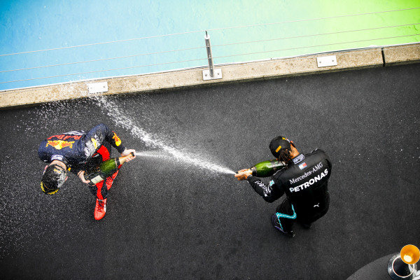Max Verstappen, Red Bull Racing and Race Winner Lewis Hamilton, Mercedes-AMG Petronas F1 celebrates on the podium with the chamapgne