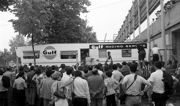 The teams and drivers were forced to take cove  in their transporters for several hours as the crowd invaded the paddock area Italian GP, Monza, 8 September 1969
