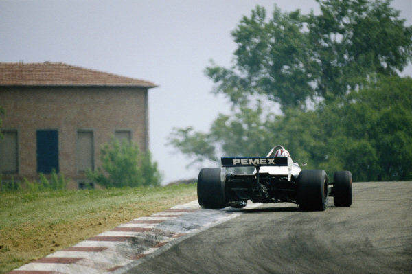 Nelson Piquet, Brabham BT49C Ford, drifts on to an exit kerb.