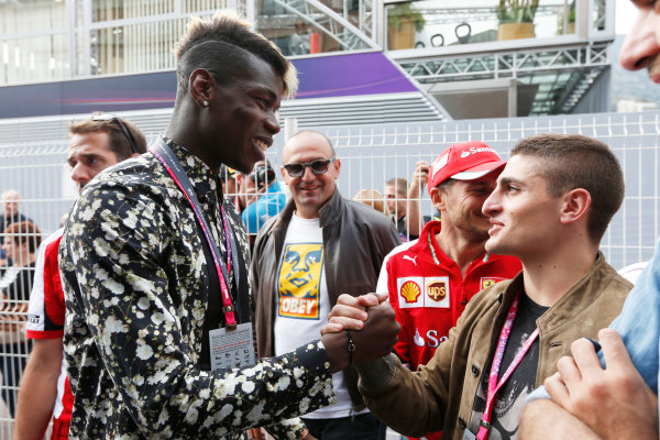 Monte Carlo, Monaco. Sunday 24 May 2015. Paul Pogba of Juventus and Paris Saint Germains Marco Verratti visit the paddock. World Copyright: Alastair Staley/LAT Photographic. ref: Digital Image _79P7033