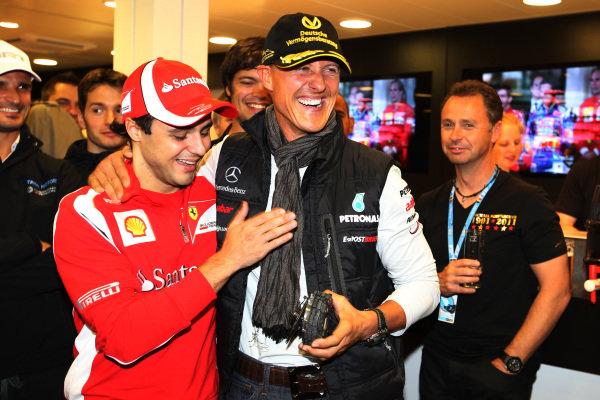 Felipe Massa (BRA) Ferrari and Michael Schumacher (GER) Mercedes GP at the 20th Anniversary party for Michael Schumacher (GER) Mercedes GP.  Formula One World Championship, Rd 12, Belgian Grand Prix, Qualifying Day, Spa-Francorchamps, Belgium, Saturday 27 August 2011.  BEST IMAGE